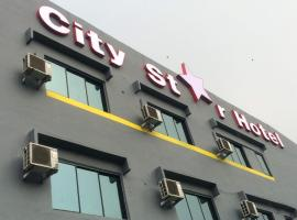大城市豪华旅馆,位于古来苏丹依斯迈路机场 - JHB附近的酒店