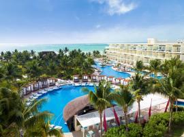 坎昆海滨阿祖尔海滩度假酒店 - 卡利斯玛美食全包,位于莫雷洛斯港的度假村