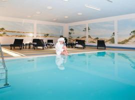 兰德豪斯埃姆格伦酒店,位于奥斯赛拜-屈隆斯博恩的酒店